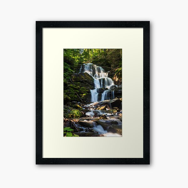 big waterfall in green forest Framed Art Print