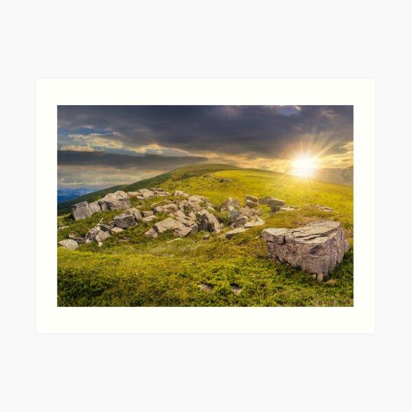 white boulders on the hillside at sunset Art Print