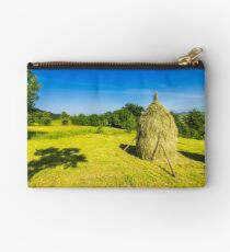 field with haystacks Studio Pouch