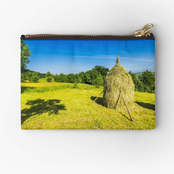 field with haystacks Zipper Pouch
