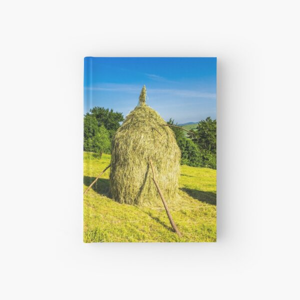field with haystacks Hardcover Journal