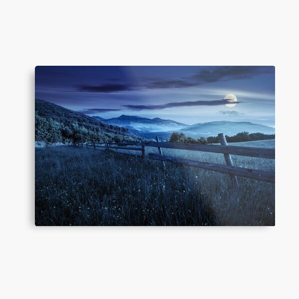 fence on hillside meadow in mountains at night Metal Print