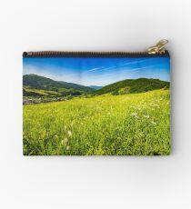 village on hillside meadow Studio Pouch