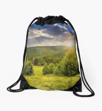 forest glade on hillside at sunset Drawstring Bag