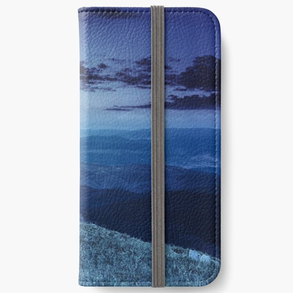 boulders on the endge of mountain at night iPhone Wallet