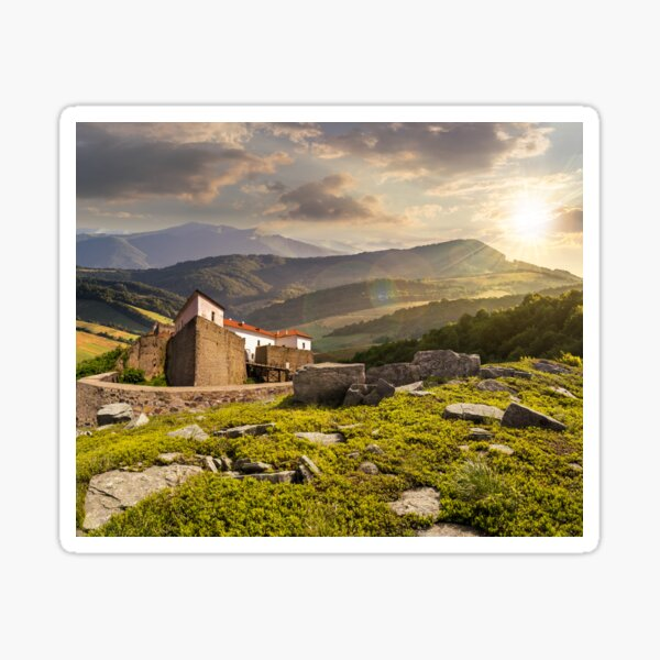 composite landscape with fortress in woods on mountain hillside at sunset Sticker