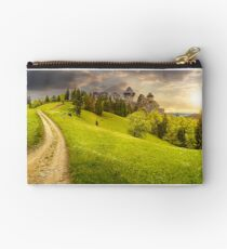path to fortress ruins on hillside with forest at sunset Studio Pouch