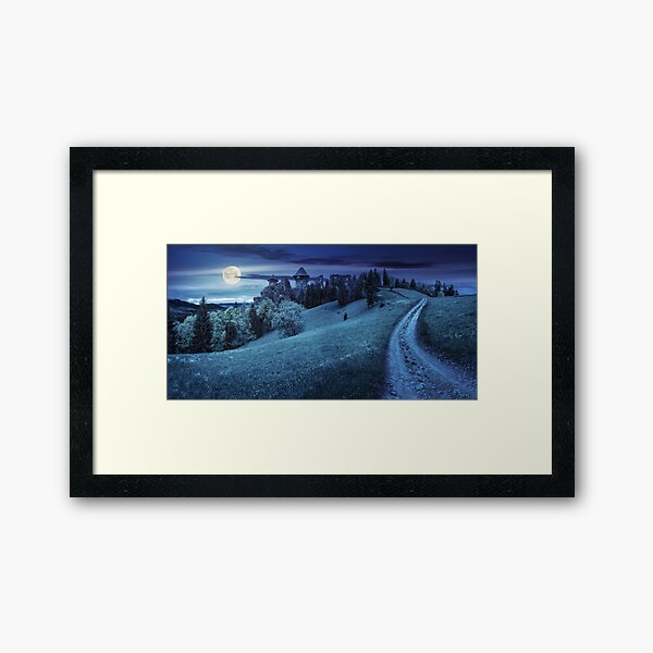 path to fortress ruins on hillside with forest at night Framed Art Print