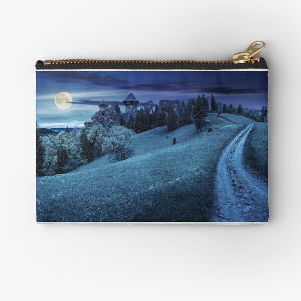 path to fortress ruins on hillside with forest at night Zipper Pouch