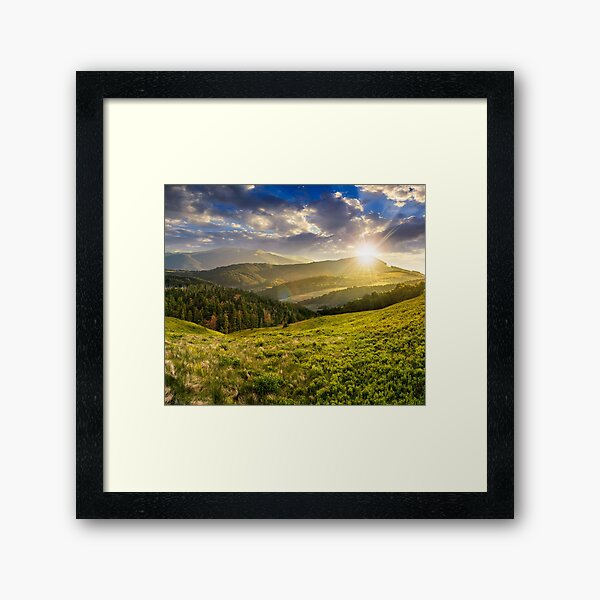 landscape with valley and forest in high mountains at sunset Framed Art Print
