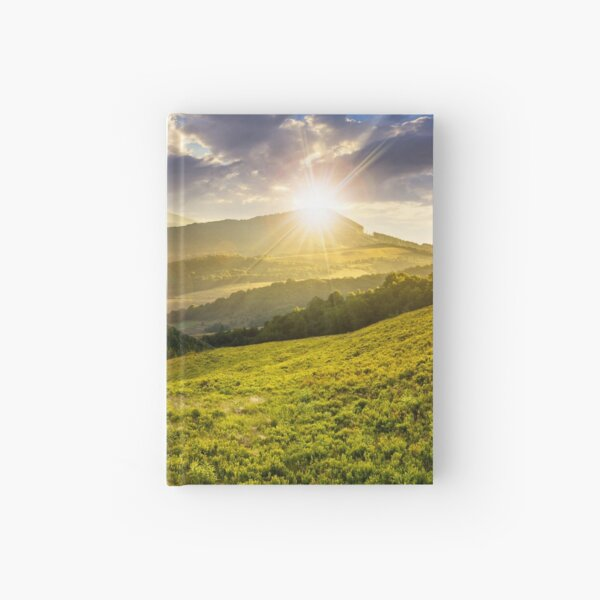 landscape with valley and forest in high mountains at sunset Hardcover Journal
