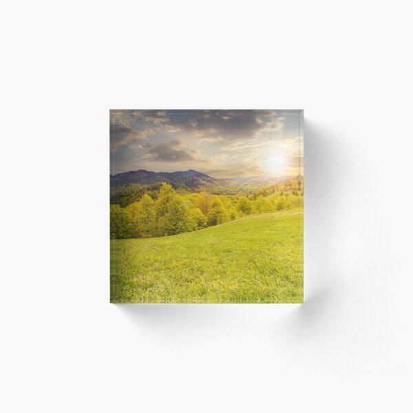 hillside meadow near forest in mountain at sunset Acrylic Block