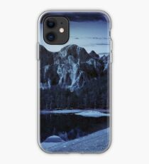 lake near the mountain in pine forest at night iPhone Case