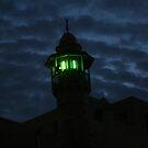 a mosque at dusk in old Jaffa by Bernard Raskin
