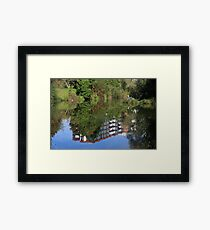 Fisherman On The Riverbank Framed Print