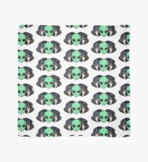 Colorful vibrant portrait of an alien from outer space face in disguise as human girl. Scarf