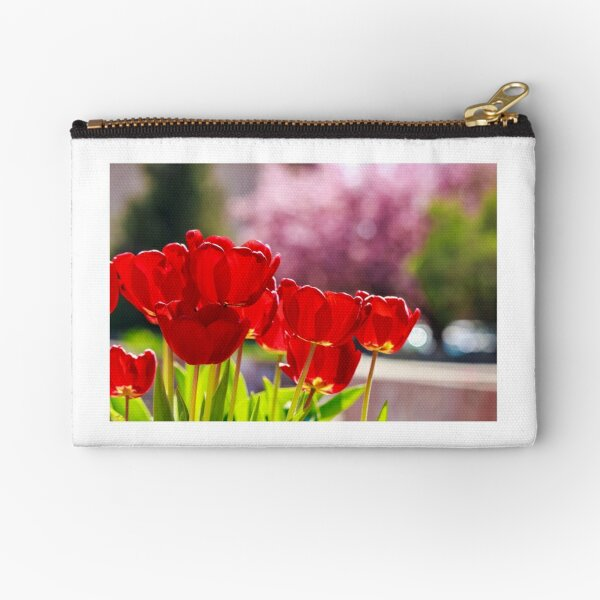 red tulip on color blurred background  Zipper Pouch