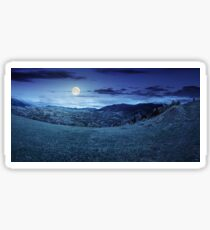 village on hillside meadow at night Sticker