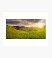 village on hillside meadow at sunset Art Print