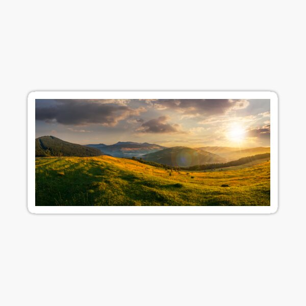 agricultural field in mountains at sunset Sticker