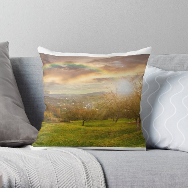 panorama of apple orchard on hillside at sunset Throw Pillow