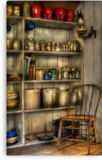 The chair in the corner of the kitchen by Mike  Savad