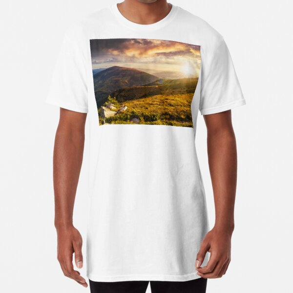 hillside with stones in high mountains at sunset Long T-Shirt