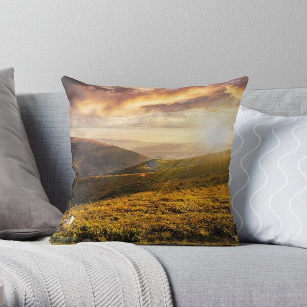 hillside with stones in high mountains at sunset Throw Pillow