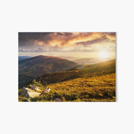 hillside with stones in high mountains at sunset Art Board Print