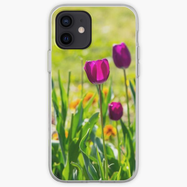 purple tulip on blurred background of grass  iPhone Soft Case