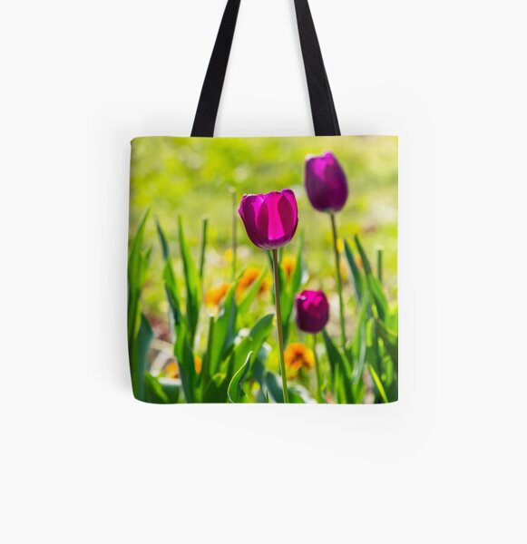 purple tulip on blurred background of grass  All Over Print Tote Bag