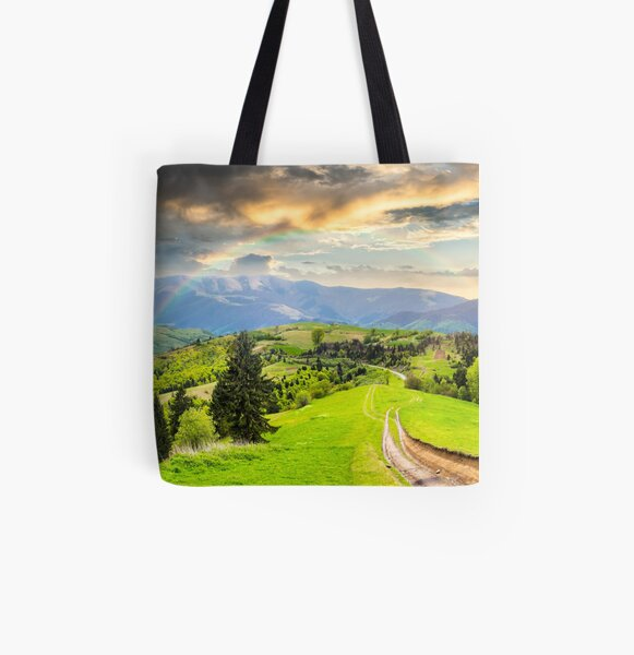 road through the meadow on hillside All Over Print Tote Bag