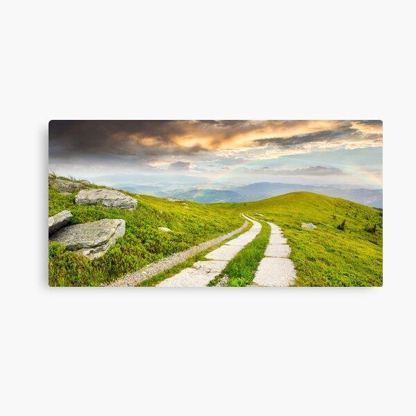 road on a hillside near mountain peak Canvas Print