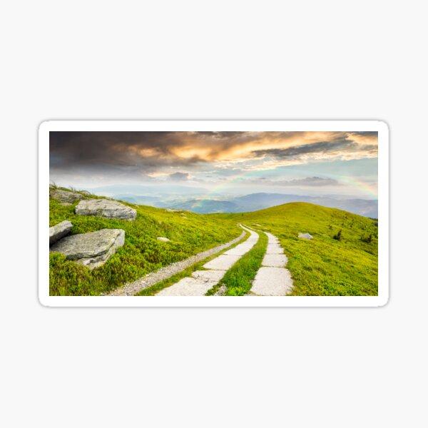 road on a hillside near mountain peak Sticker
