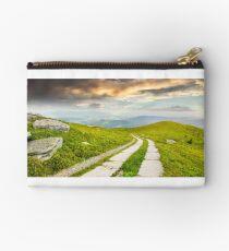 road on a hillside near mountain peak Studio Pouch