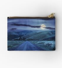abandoned road through meadows in mountain at night Studio Pouch
