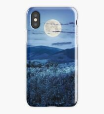 meadow with flowers in mountains at night iPhone Case