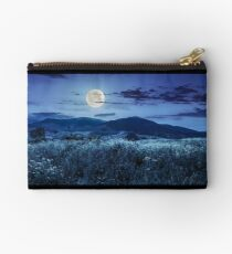 meadow with flowers in mountains at night Studio Pouch