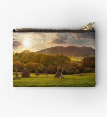 agriculture field in mountains at sunset Studio Pouch