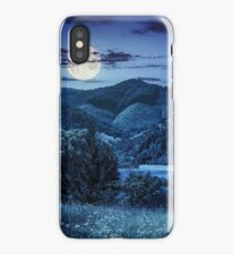 pine trees near meadow in mountains at night iPhone Case