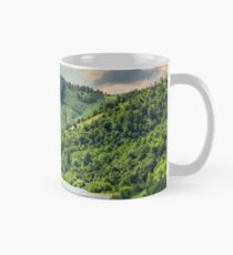 pine trees near meadow in mountains Classic Mug