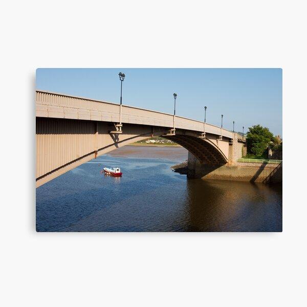 Arch Bridge Over a Boat Canvas Print