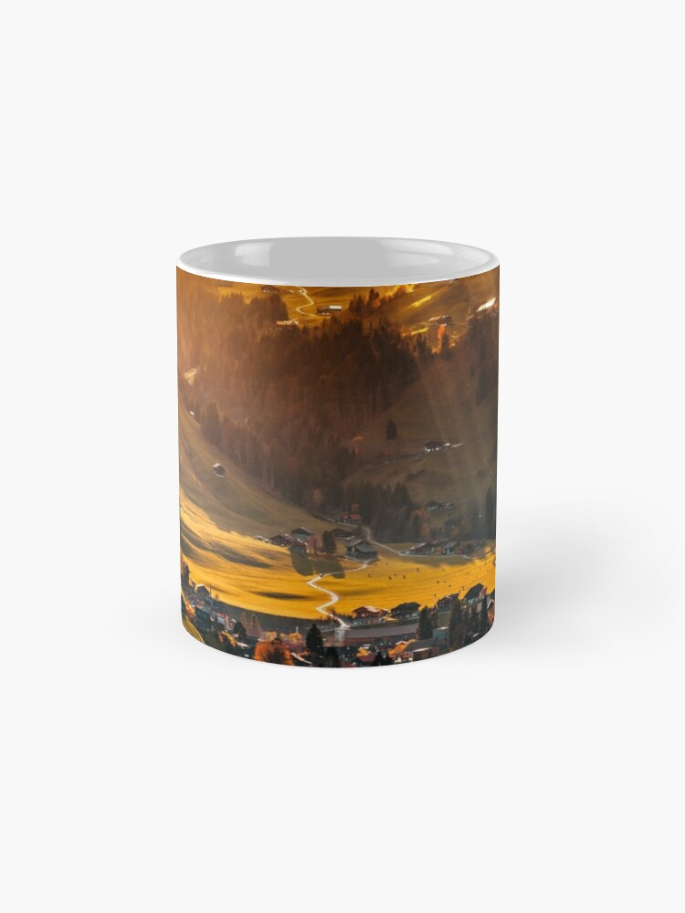 Alternate view of Sun beams lighting through the clouds and falling down to the little village on the hill Mug