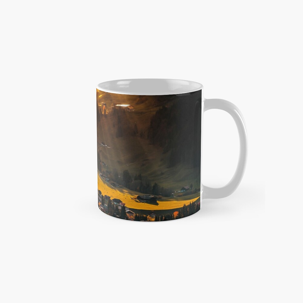 Sun beams lighting through the clouds and falling down to the little village on the hill Mug
