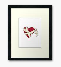 Damaged Heart Framed Print