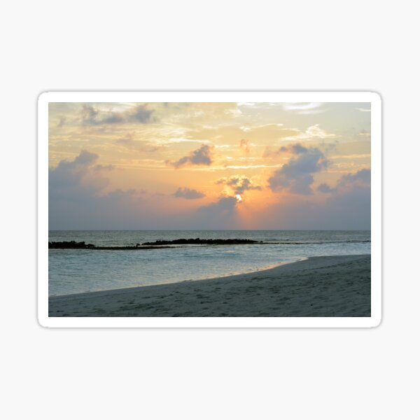Sunset on a cloudy sky in the Maldives Sticker