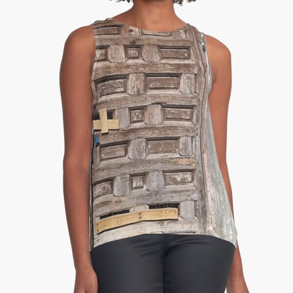 The old door in the old house of the historic district of a Spanish city Sleeveless Top