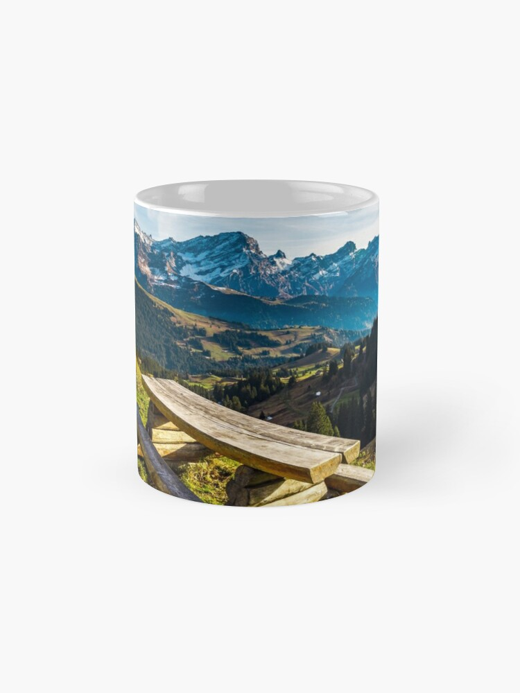 Alternate view of Natural wooden table with benches on the pederstrian path in Alps Mug