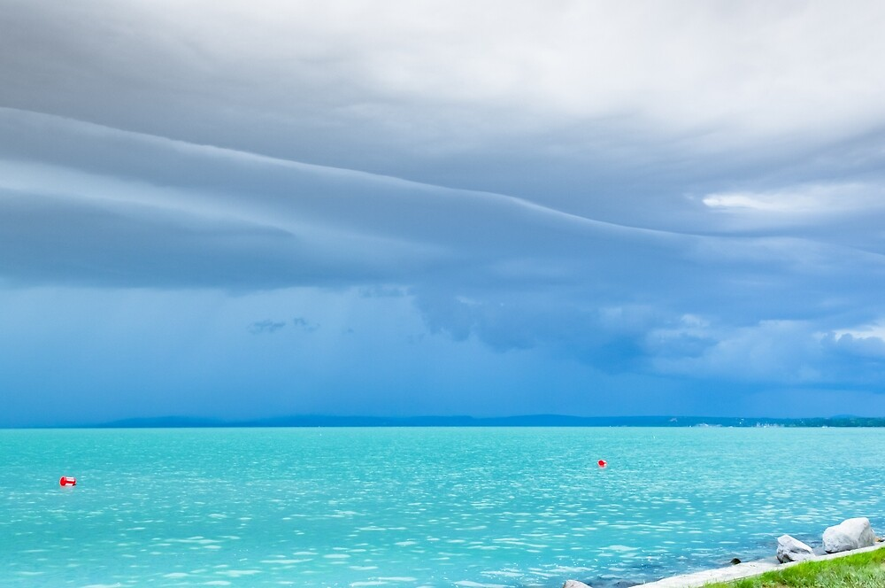 Summer storm at a turquoise, clean lake by horizonphoto