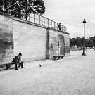 Stranger sitting at Place de la Concorde by dreikelvin